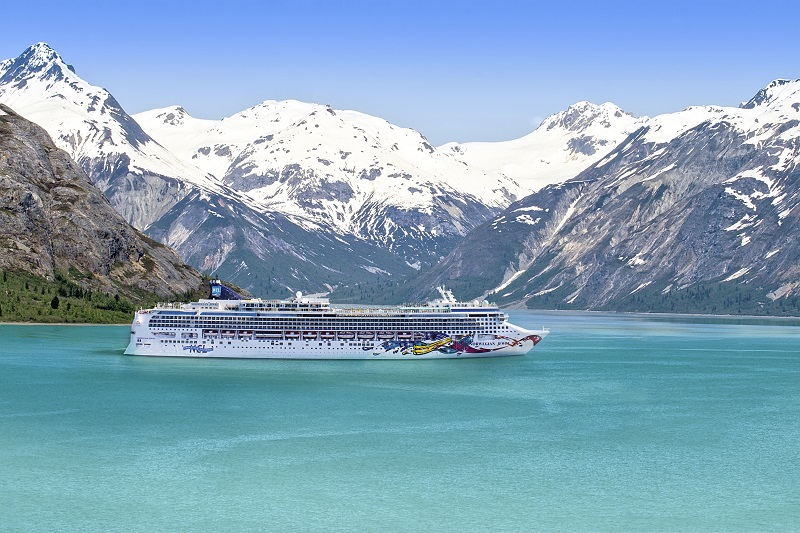 Mountain range and ocean waters in Glacier Bay National Park, Alaska_credits Courtesy of Press Office
